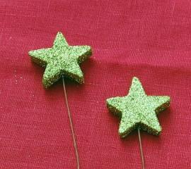 Glitzernde Sterne in hellem Grün - Bild vergrößern